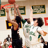 Classical's Jalen Brown (10) and Ryan Hayward (0) attempt to block a shot by Salem's Davonte Holloway (23) during their game on Thursday, December 22. Item Photo / Angela Owens.