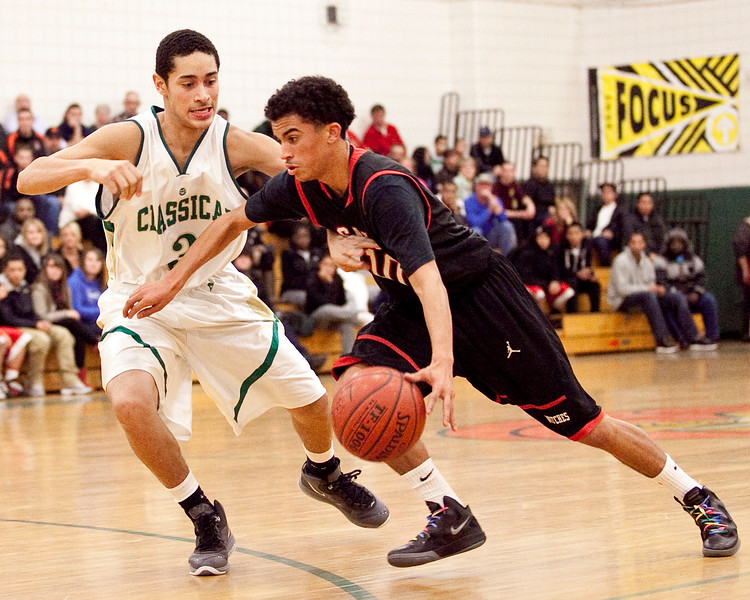 Classical's Eddie Solis (3) guards Salem's Marvin Baez (10) during their game on Thursday, December 22. Item Photo / Angela Owens.