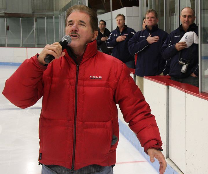 Rene Rancourt singing the National Anthem before the start of the Lynn Youth Hockey-Canada tournament at the Connery Rink on Friday.