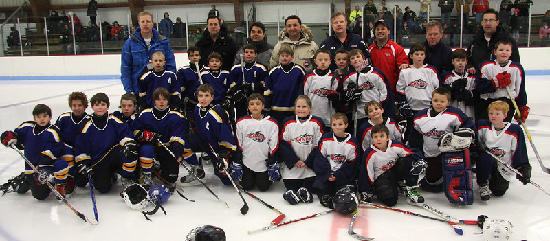 Players in the Canadian, left, and Lynn Youth Hockey tournament at Connery Rink on Friday.