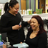 Ganelin Roman, a sophomore in the cosmetology department at Lynn Tech, gives her mother, Miguelina Roman, a belated Mother's Day gift.