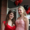 (from left) Heather McKenney and Emily Dumas pose for a picture before loading buses to the prom Friday My 27, 2011. Item Photo/ Reba M. Saldanha