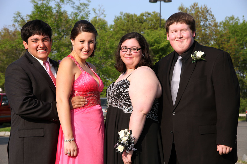 (from left) Paul Gerrero, Nicole Chaisson, Allison solomon, and Brian Welch pose for a picture before loading buses to the prom Friday My 27, 2011. Item Photo/ Reba M. Saldanha