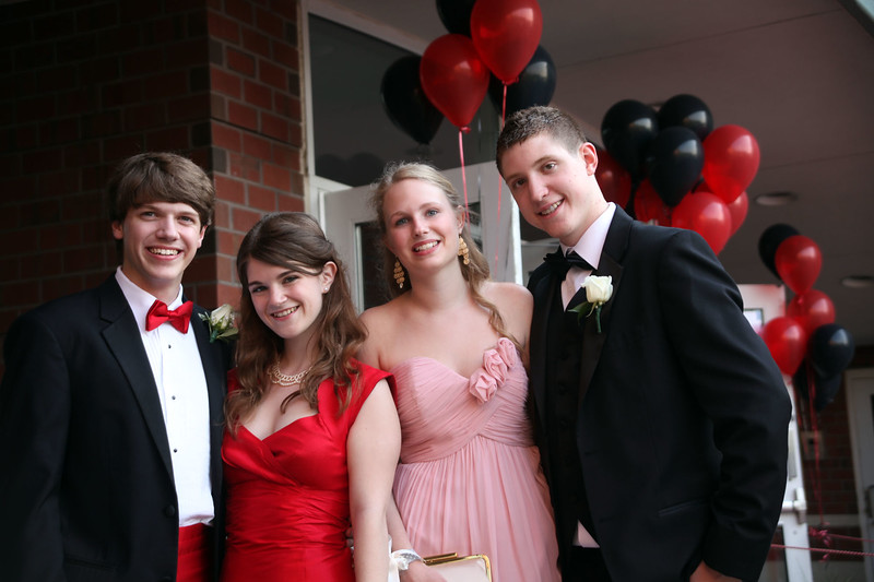 (from left) Danny Kennedy, Heather McKenney, Emily Dumas and Jordan Dooley pose for a picture before loading buses to the prom Friday My 27, 2011. Item Photo/ Reba M. Saldanha