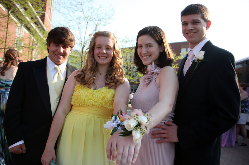 (from left) Andrew Dimare, Hannah James, MacKenzie Condon, and Justin Dunleavy pose for a picture before loading buses to the prom Friday My 27, 2011. Item Photo/ Reba M. Saldanha