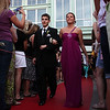 Prom goers walk the red carpet before loading buses to the prom Friday My 27, 2011. Item Photo/ Reba M. Saldanha