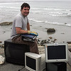 Christopher Swain poses for a photo near Nahant's Long Beach with some of the electronics he collected Monday May 23, 2011. Item Photo/ Reba M. Saldanha