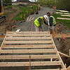 Jay Reyonalds, left, and Gary Nicholson, work on the forms for the stairs at High Rock Tower today.