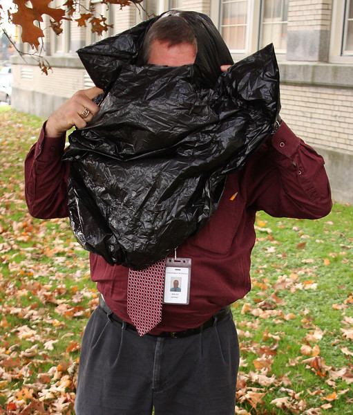 Lynn English physics teacher Jeffrey Bigler gets ready to participate in the egg drop project held at Lynn English today.