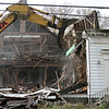A demolition crew began tearing down a long- abandoned church on Burrill Street Tuesday to make way for a condominium development.