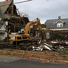 The rectory section of a long-abandoned church on Burrill Street and Rock Avenue is open to the elements after a demolition crew took down the sanctuary portion of the structure.