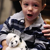 Jack Chevalier holding a puppet at the Mother Goose Story time at the Lynn Public Library today.