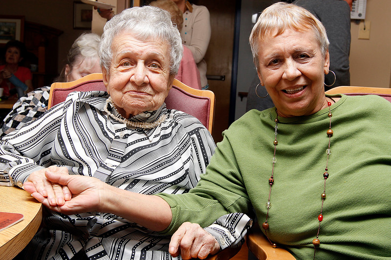 Amelia Burgess sits with her daughter, Corinne Waldrin, during Amelia's 100th birthday party at Phillips Manor on Wednesday, November 16. Item Photo / Angela Owens.
