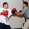 Isaiah Perez and Nick Chum demonstrate boxing skills during the health fair at Ford Elementary School on Wednesday, November 16. Item Photo / Angela Owens.