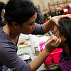 Linda Son paints the face of Marienece Perez during the health fair at Ford Elementary School on Wednesday, November 16. Item Photo / Angela Owens.
