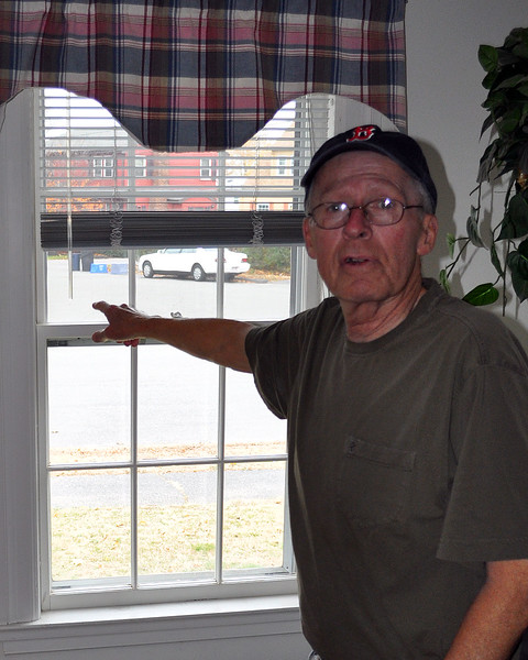 Thomas Roughan points out his window to wear the tanker trucks make their wide turns. Item Photo / Matt Tempesta