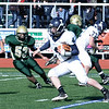Thankgiving game Lynnfield vs N. Reading.<br /> #4 Kyle McGah, Lynnfield, with ball, #77 Dwight DeGeorge, Lynnfield, #53 Michael Moscaritolo, N. Reading.