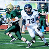 Thankgiving game Lynnfield vs N. Reading.<br /> #3 Evan Wade, North Reading with ball, #72 John Gaff, Lynnfield