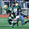 Thankgiving game Lynnfield vs N. Reading.<br /> #30 Charles McCarthy, N. Reading with ball, tackle by #22 Tyler Palumbo Lynnfield, #66 Michael Cresta, N. Reading