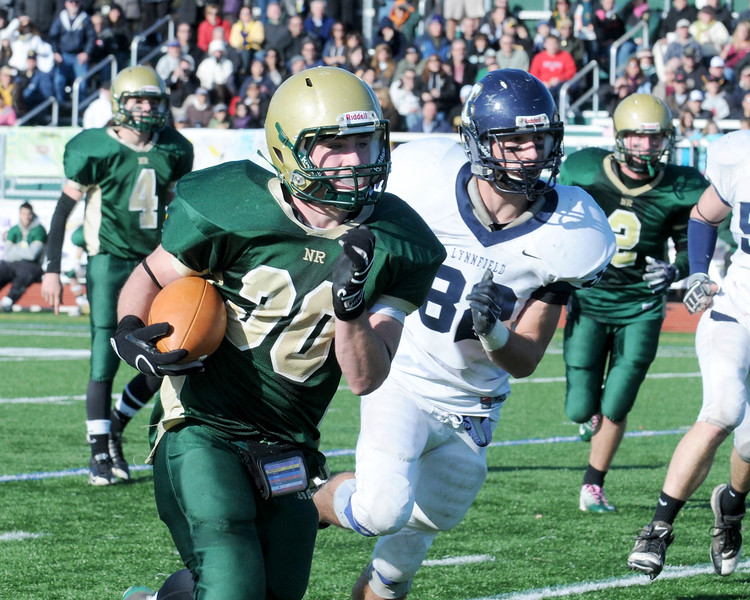 Thankgiving game Lynnfield vs N. Reading.<br /> #30 Charles McCarthy, N. Reading with ball. #82 Michael Soden, Lynnfield. #2 Kyle Boucher and #4 Jackson Kellogg both N. Reading.