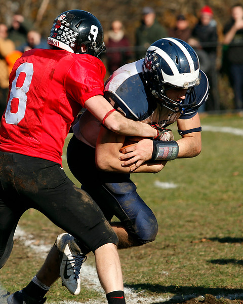 Marblehead's Bing Bial (8) attempts to tackle Swampscott's Michael Walsh (13) during their game at Christopher Piper Field in Marblehead on Thursday, November 24. Item Photo / Angela Owens.