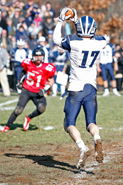 Swampscott's Richard Sullivan (17) catches a pass from Michael Walsh (13) during their game against Marblehead at Christopher Piper Field in Marblehead on Thursday, November 24. Item Photo / Angela Owens.