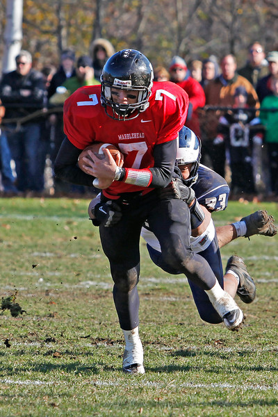 Marblehead's Ian Maag (7) is tackled by Swampscott's #33 during their game at Christopher Piper Field in Marblehead on Thursday, November 24. Item Photo / Angela Owens.