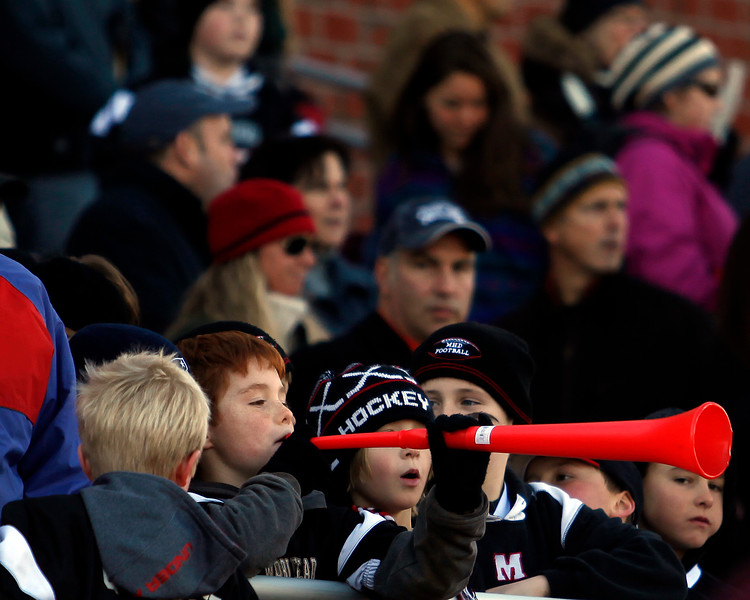 A young Marblehead fan blows into a vuvuzela during the Thanksgiving game against Swampscott at Christopher Piper Field in Marblehead on Thursday, November 24. Item Photo / Angela Owens.