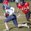 Swampscott's Richard Sullivan (17) gains some yards before being tackled by Marblehead's John Perry (40) during their game at Christopher Piper Field in Marblehead on Thursday, November 24. Item Photo / Angela Owens.