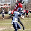 Marblehead's Brian Daly (12) attempts to catch a pass, but is thwarted by Swampscott's Robert Serino (5) and the pass is incomplete, during their game at Christopher Piper Field in Marblehead on Thursday, November 24. Item Photo / Angela Owens.