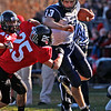 Marblehead's Zac Cuzner (25) drives Swampscott's Michael Walsh (13) out of bounds during their game at Christopher Piper Field in Marblehead on Thursday, November 24. Item Photo / Angela Owens.