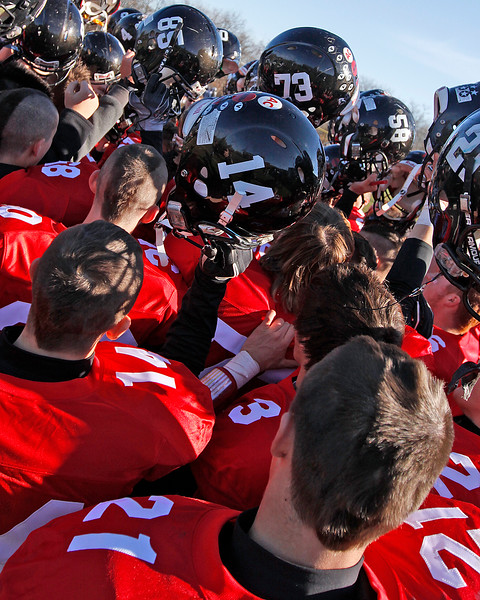 Marblehead's varsity football players hold their helmets over their heads in celebration of their victory over Swampscott at Christopher Piper Field in Marblehead on Thursday, November 24. Item Photo / Angela Owens.