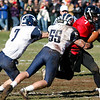 Swampscott's #7 and Zach Kalapinski (55) attempt to tackle Marblehead's Ian Maag (7) during their game at Christopher Piper Field in Marblehead on Thursday, November 24. Item Photo / Angela Owens.