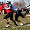 Marblehead's John Perry (40) is tackled by Swampscott's Nick Meninno (27) during their game at Christopher Piper Field in Marblehead on Thursday, November 24. Item Photo / Angela Owens.