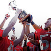 Marblehead's Sam York (52) and teammates hold up their Thanksgiving Day Football Champions trophy after they beat Swampscott at Christopher Piper Field in Marblehead on Thursday, November 24. Item Photo / Angela Owens.
