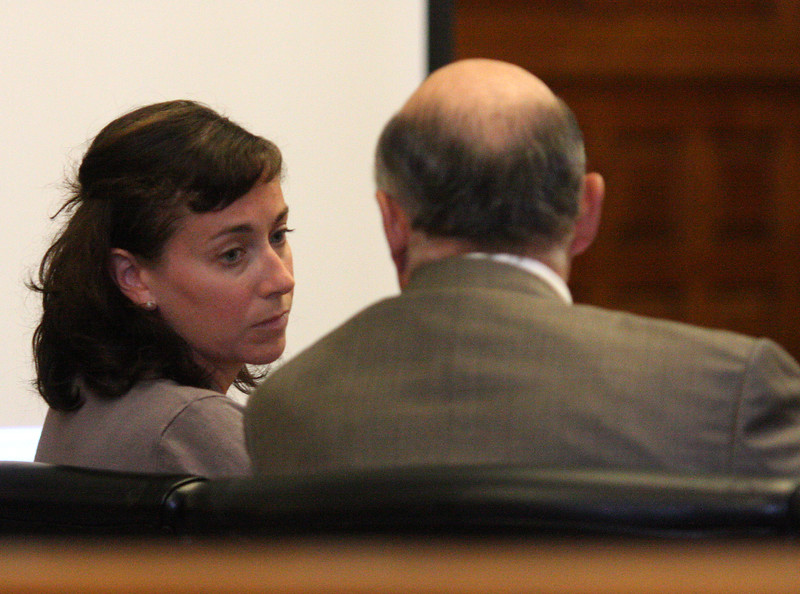Catherine Foley talking to her lawyer Neil Rossman after he asked Judge Howard Whitehead to drop charges.