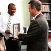 Fitzroy Alexander, President of Traditional Breads, gets his award from Lt. Gov. Tim Murray.
