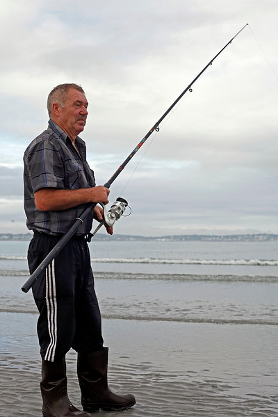 Klinac Edo, who has been living in Lynn for ten years, fishes on Nahant Beach on Thursday, September 22, 2011. By Angela Owens.