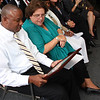 Fitzroy Alexander, President of Traditional breads, looking at his award with Joanne Goldstein, Sec. of Labor and Workforce Development, at the awards event today at the New American center in Lynn.