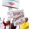 Rosalina Alcantara (left) and Wilkin Frias, age 9 (right) protest outside the Bank of America on Market St in Lynn on Thursday, September 22, 2011. By Angela Owens.