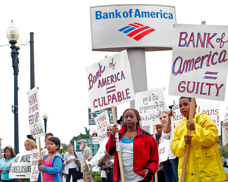 Members of Lynn United for Change, some of whom have had their homes foreclosed, protest outside the Bank of America on Market St in Lynn on Thursday, September 22, 2011. By Angela Owens.