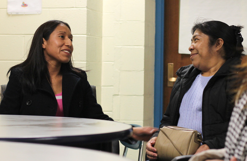Ieda Roblero, left, and Paula Crisostomo, right are members of the Ingalls School parent participation program. Photo by Owen O'Rourke