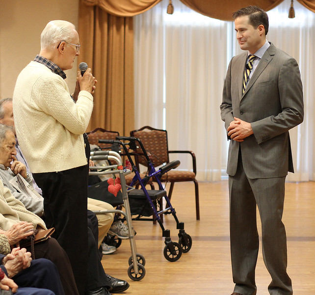 Brooksby Village resident Dr. Phil Snodgrass asks Congressman Seth Moulton his views about bringing back the draft during a question and answer session at Brooksby today. This was Congressman Moulton's first visit to Brooksby since his election in November. Photo by Owen O'Rourke