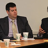 State Representative Robert Fennell, left,and State Representative Steve Walsh listen to State Senator Thomas McGee, right, talk at the Lynn Business Partnership meeting today held at the Eastern Bank in Lynn today. Photo by Owen O'Rourke