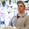 Bernardo Colon gives his opinion on the new pope, while working at Jimenez Market on Wednesday, March 13. Item Photo / Angela Owens.