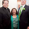 From left, Reverend Brian Flynn, Major Judy Flanagan Kennedy, and Irishman of the Year Michael Reddy pose for a photo during the Friendly Knights of Saint Patrick dinner at Old Tyme Italian Cuisine on Thursday, March 13. Item Photo / Angela Owens.