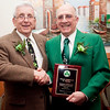 David Solimine Sr and Community Service Award winner Patrick Gecoya pose for a photo during the Friendly Knights of Saint Patrick dinner at Old Tyme Italian Cuisine on Thursday, March 13. Item Photo / Angela Owens.