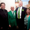 From left, Reverend Brian Flynn, Community Service Award winner Patrick Gecoya, Irishman of the Year Michael Reddy, and Mayor Judy Flanagan Kennedy pose for a photo during the Friendly Knights of Saint Patrick dinner at Old Tyme Italian Cuisine on Thursday, March 13. Item Photo / Angela Owens.