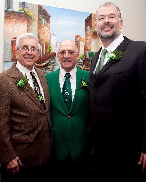 From left, David Solimine Sr, Community Service Award winner Patrick Gecoya, and William McDonal pose for a photo during the Friendly Knights of Saint Patrick dinner at Old Tyme Italian Cuisine on Thursday, March 13. Item Photo / Angela Owens.
