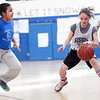 Drewicz's Jessica Reyes (24) guards Sisson's Katherine Clancy (2) during their game at Pickering Middle School on Thursday, March 14. Item Photo / Angela Owens.